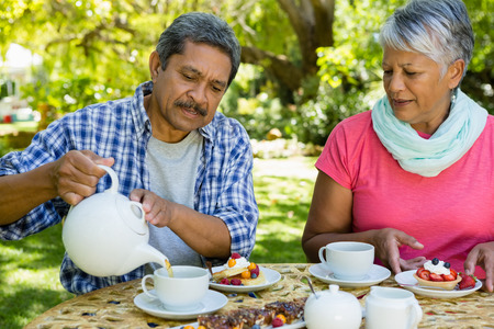Senior couple drinking tea at the park Stock Photo