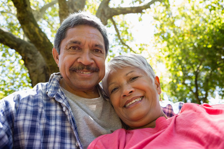 Senior couple taking a selfie at the park Stock Photo
