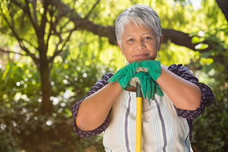 Portrait of senior woman standing in garden on a sunny day