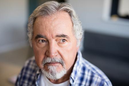 Thoughtful senior man looking away at nursing home