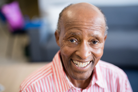 Portrait of smiling senior man with receding hairline at nursing home