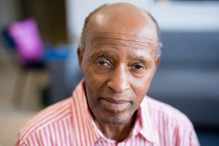 Portrait of senior man with receding hairline at nursing home