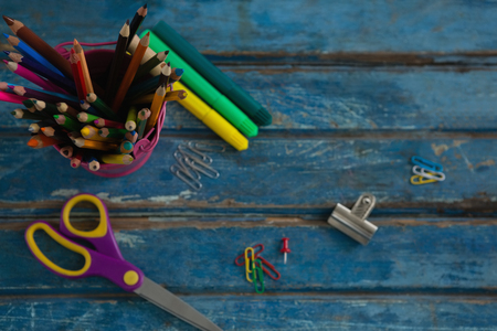 Overhead view of various school supplies on wooden table Stock Photo
