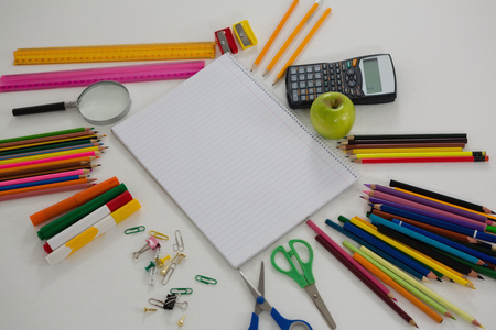 drawing pin: Close-up of various school supplies arranged on white background Stock Photo