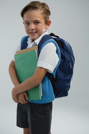 Portrait of happy schoolboy holding books Reklamní fotografie