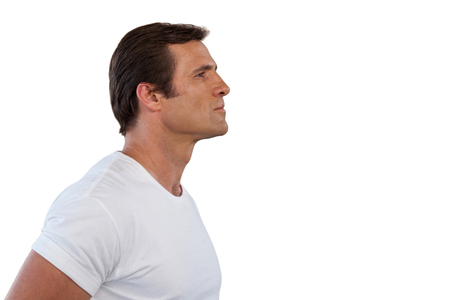 Side view of mature man looking away against white background Stock Photo