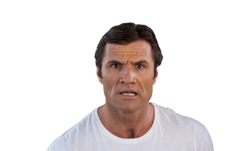 Portrait of surprised man against white background