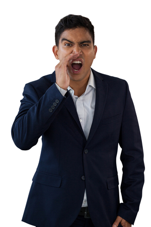 Portrait of businessman shouting against white background Stock Photo