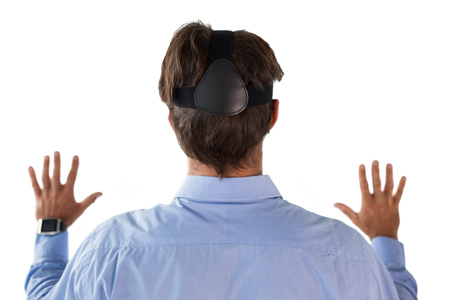 Rear view of businessman wearing vr glasses against white background