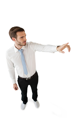 High angle view of businessman touching invisible interface against white background Stock Photo