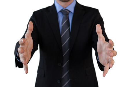 Mid section of businessman in suit marketing invisible product while standing against white background