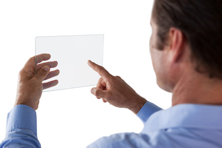 Cropped image of businessman using glass interface against white background Stock Photo