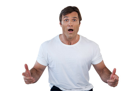 conquering adversity: Portrait of shocked mature man gesturing with mouth open against white background