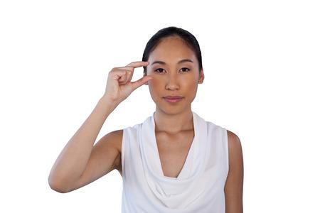 Portrait of businesswoman adjusting invisible eyeglasses against white background Stock Photo