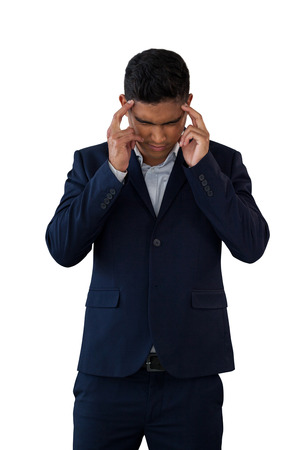 Businessman with head in hand suffering from headache against white background