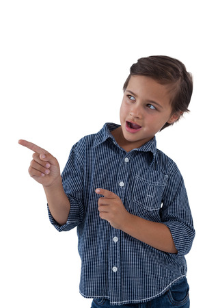 checker: Cute boy pointing finger against white background