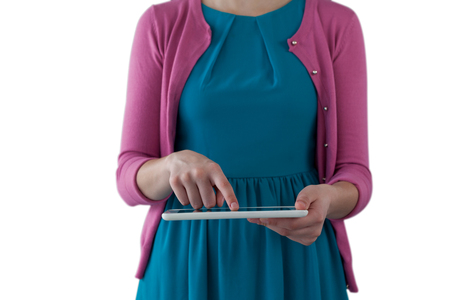 Mid section of girl using digital tablet against white background