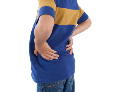 Mid-section of boy having an stomach back against white background
