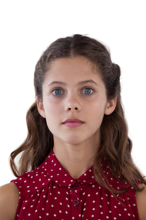 Confused girl standing against white background