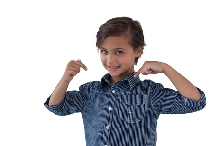 checker: Happy boy pointing at him against white background