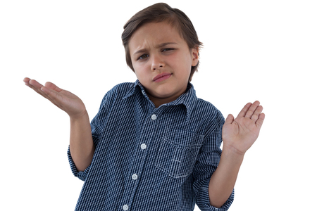 checker: Frowning boy shrugging his shoulders against white background