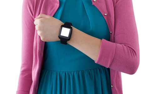 Mid section of teenage girl showing her smartwatch