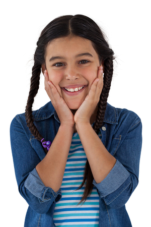 Portrait of smiling cute girl standing against white background