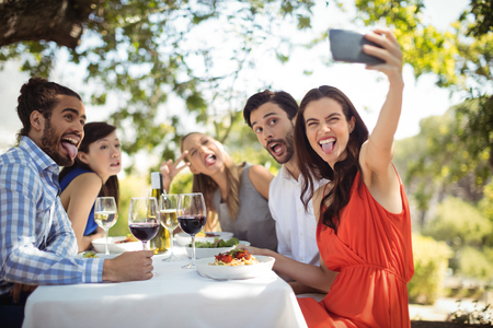 Group of friends clicking a selfie in a restaurant