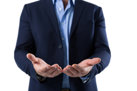 Mid section of helpless businessman showing his hands Stock Photo