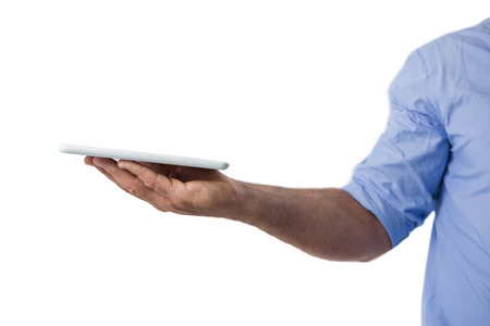 Man holding digital tablet against white background