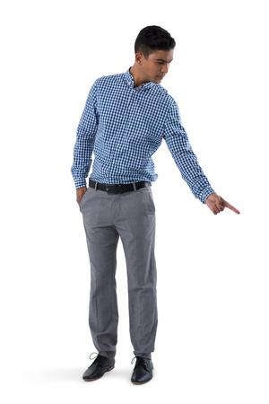 Confident man gesturing against white background