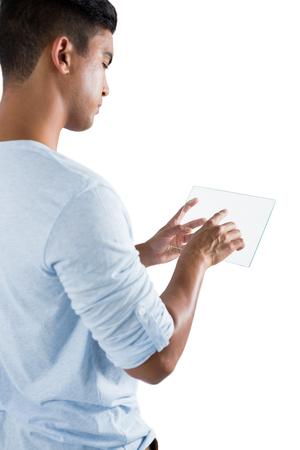 Man using glass digital tablet against white background