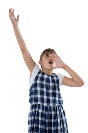 Cute girl shouting against white background Stock Photo