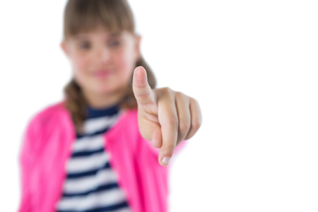 invisible: Girl pretending to touch an invisible screen against white background