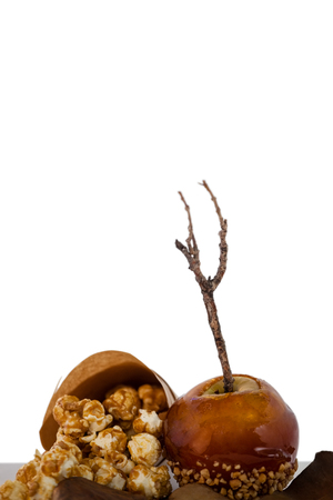 Close-up of decorated apple against white background