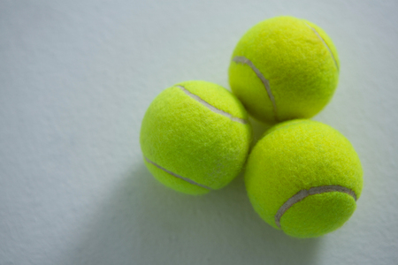 Overhead view of tennis balls on white background