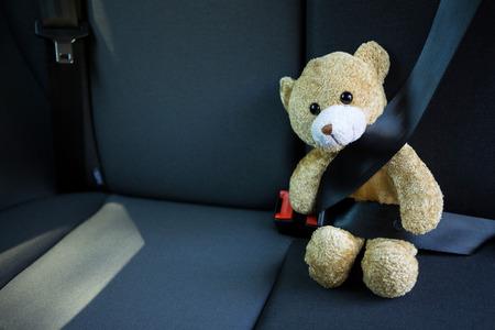 Close-up of teddy bear fastened in seat belt of car Reklamní fotografie