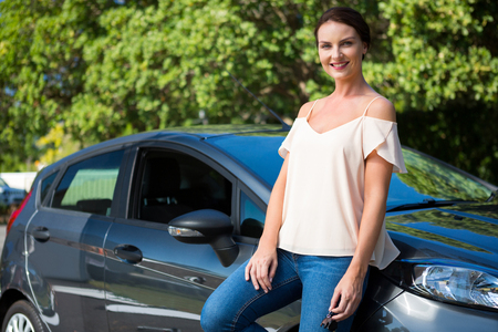 shiny car: Portrait of beautiful woman leaning on a car Stock Photo