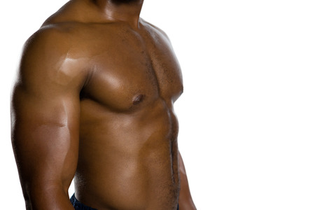 Mid section of shirtless muscular player against white background