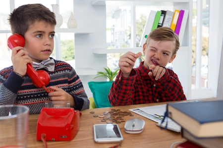 Kids as business executives working together in office Stock Photo