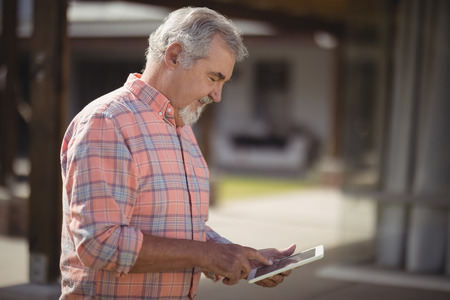 Senior man using digital tablet on a sunny day Stock Photo