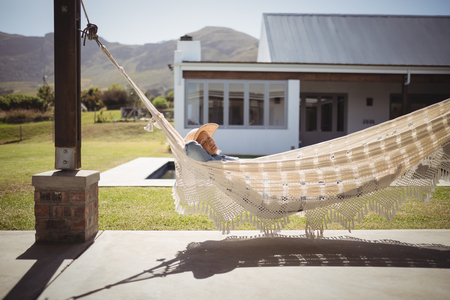 comfortable: Senior woman relaxing on hammock on a sunny day