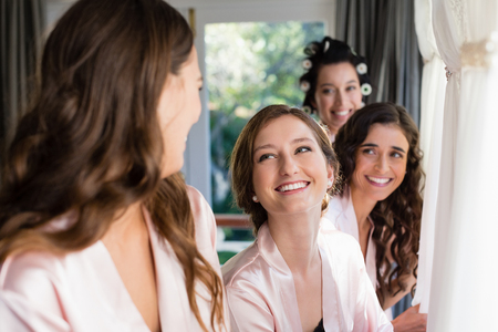 Smiling woman interacting with each other at home