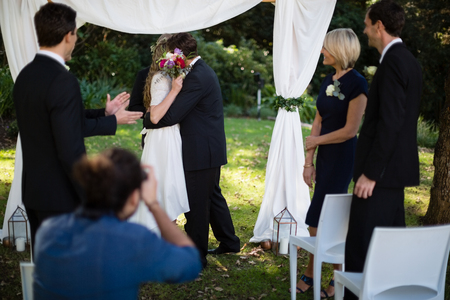 Couple Embracing Each Other During Wedding In Park Photo