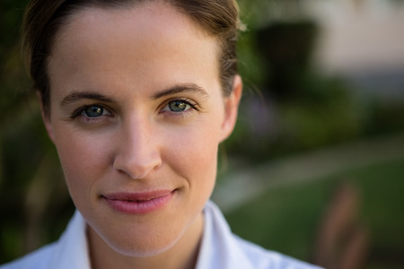 Close up portrait of confident female doctor in park Stock Photo