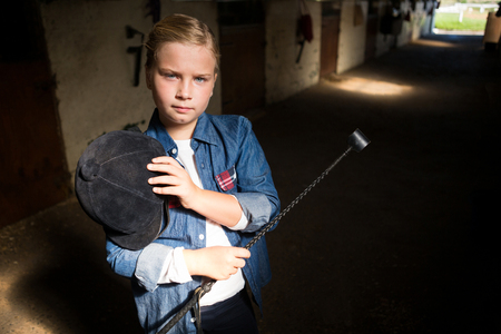 Portrait of girl standing in the stable