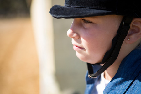 Thoughtful girl sitting in the ranch on a sunny day Stock Photo