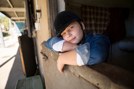 Portrait of girl relaxing in the stable