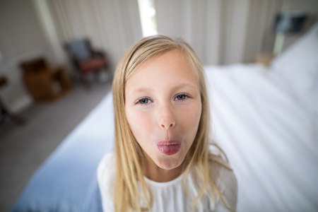 domicile: Portrait of girl pouting in bedroom at home Stock Photo