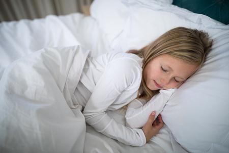 Girl sleeping on bed in bedroom at home Banco de Imagens - 83604983